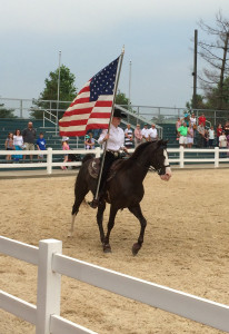 The American flag carried out at the end of the Breeds Barn show at Kentucky Horse Park. Photo by D Jørgensen.