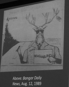 Editorial cartoon showing the caribou which had been relocated to Maine trying to hitch a ride back home to Newfoundland.